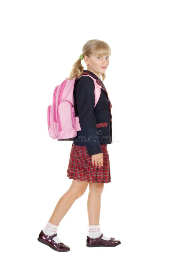 Het gelukkige schoolmeisje gaat naar school royalty-vrije stock foto's
