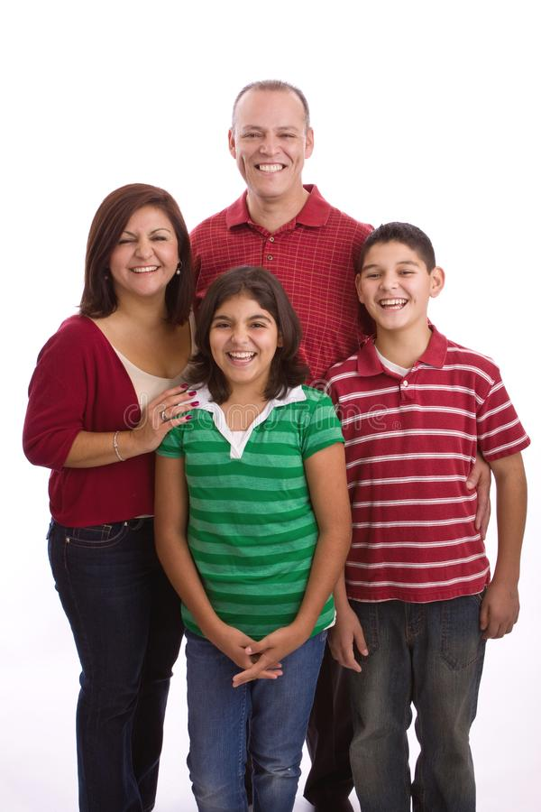 Het gelukkige Spaanse familie koesteren geïsoleerd op wit royalty-vrije stock foto