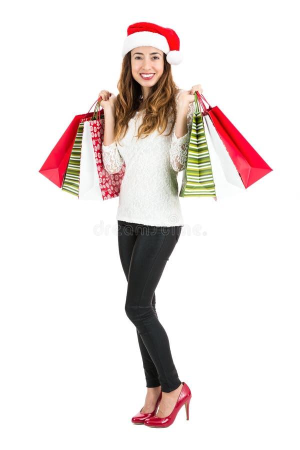 Het gelukkige volledige lichaam van de Kerstmis winkelende vrouw stock afbeelding