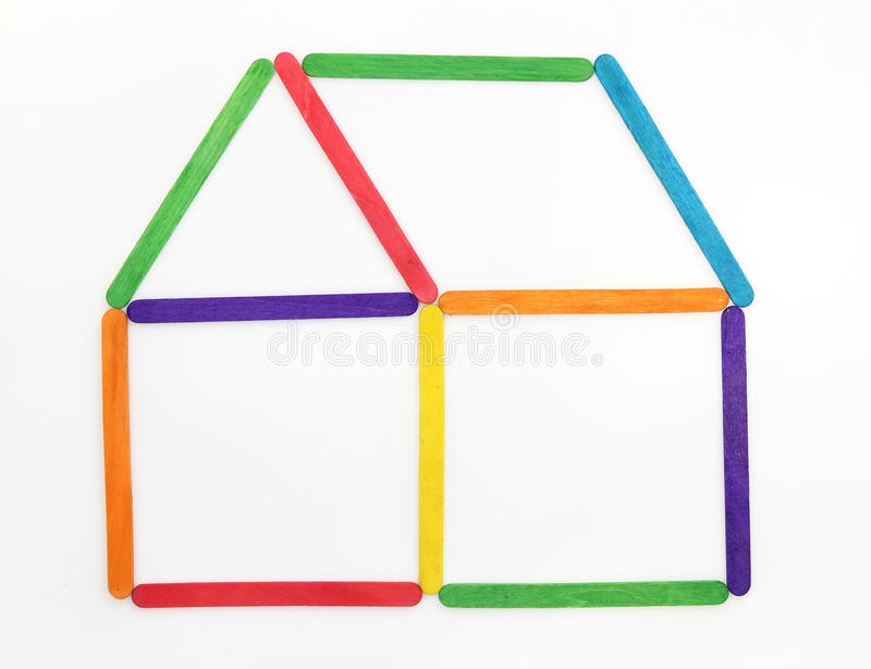 Het gemaakte kleurrijke hout van het huis pictogram stock foto's