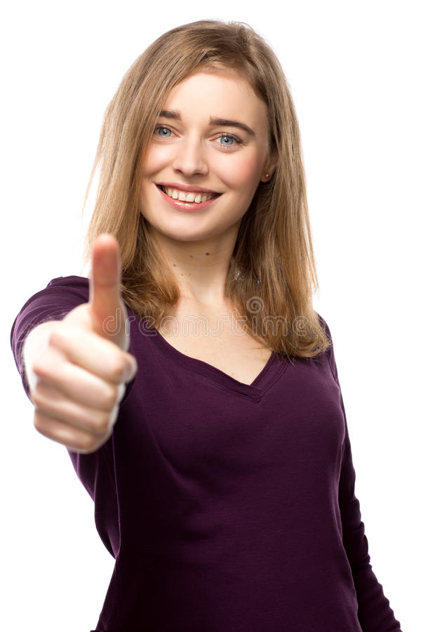Het gemotiveerde jonge vrouw geven duimen omhoog stock afbeeldingen