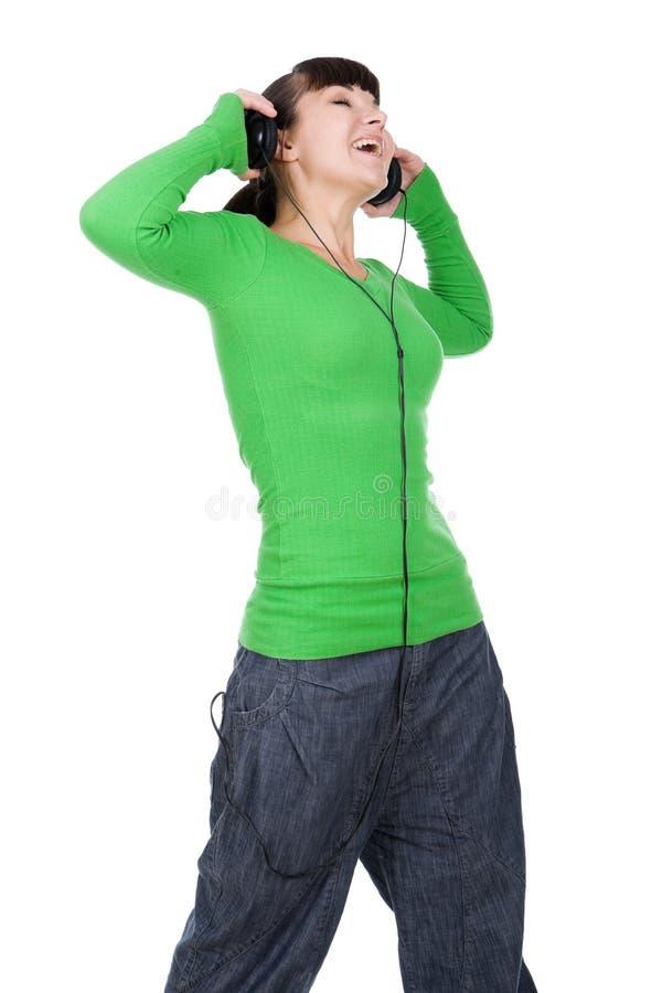 Het genieten van van muziek stock afbeelding