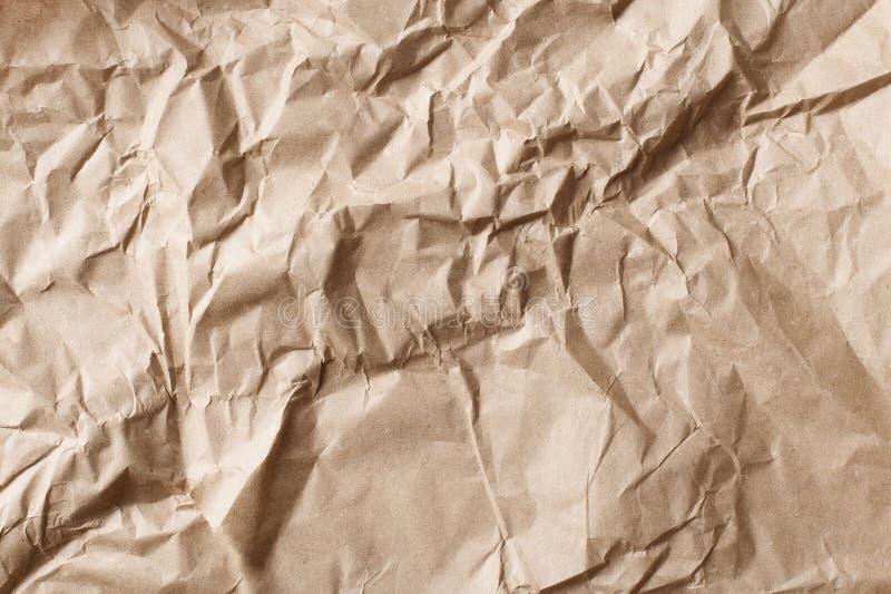 Het gerimpelde en verfrommelde document, de textuur en de achtergrond van kraftpapier grijze oude royalty-vrije stock fotografie