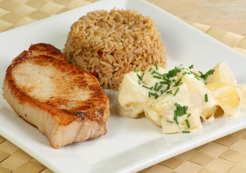 Het geroosterde lapje vlees van het varkensvleeslendestuk stock foto's
