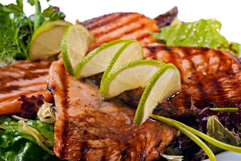 Het geroosterde lapje vlees van zalmvissen stock afbeelding