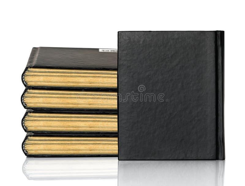 Het gesloten zwarte boek legt op witte achtergrond royalty-vrije stock afbeelding