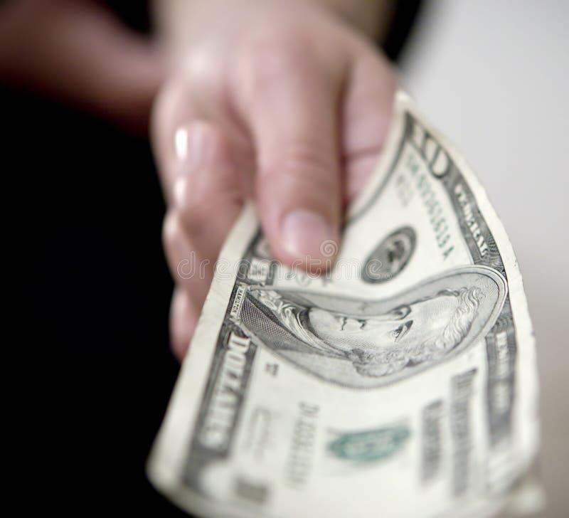 Het geven van geld A stock foto's