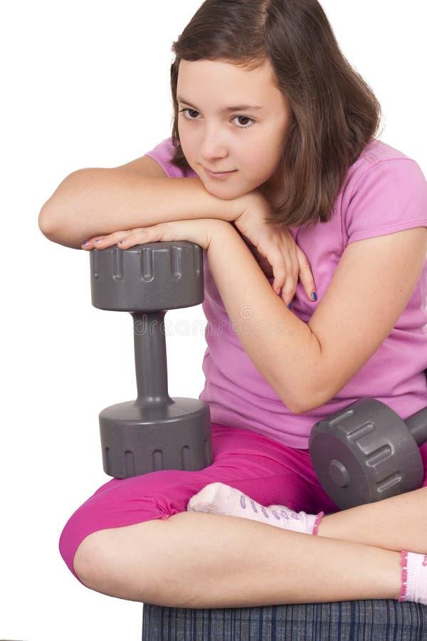 Het gewicht van de tienerholding stock foto