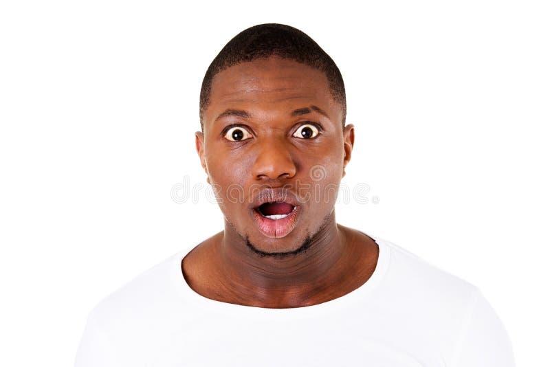 Het gezicht die van het knappe mannetje schok tonen. stock afbeelding