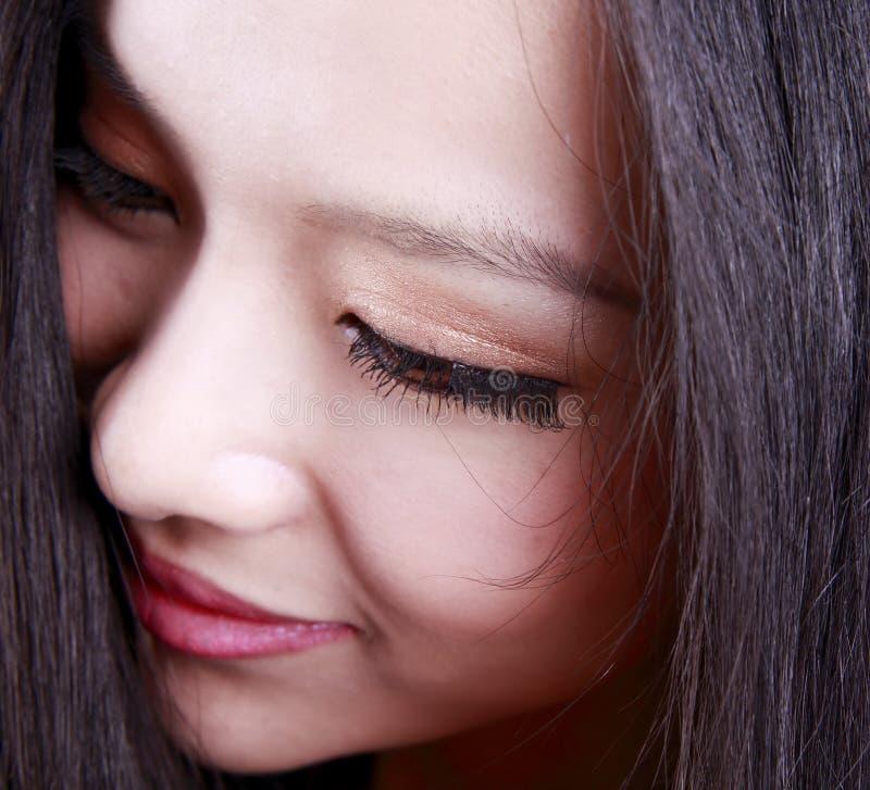 Het gezicht van de Aziatische vrouw stock foto's