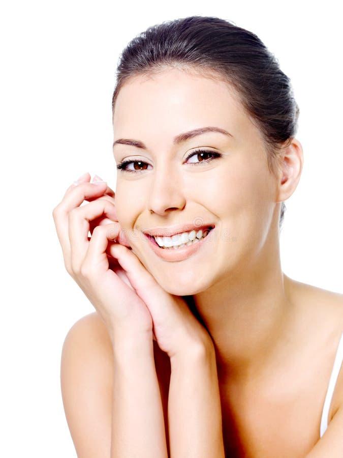 Het gezicht van de gelukkige vrouw met schone huid royalty-vrije stock foto