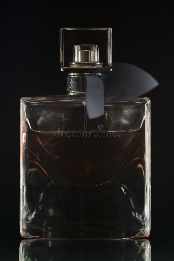 Het gezicht van de parfumfles stock fotografie