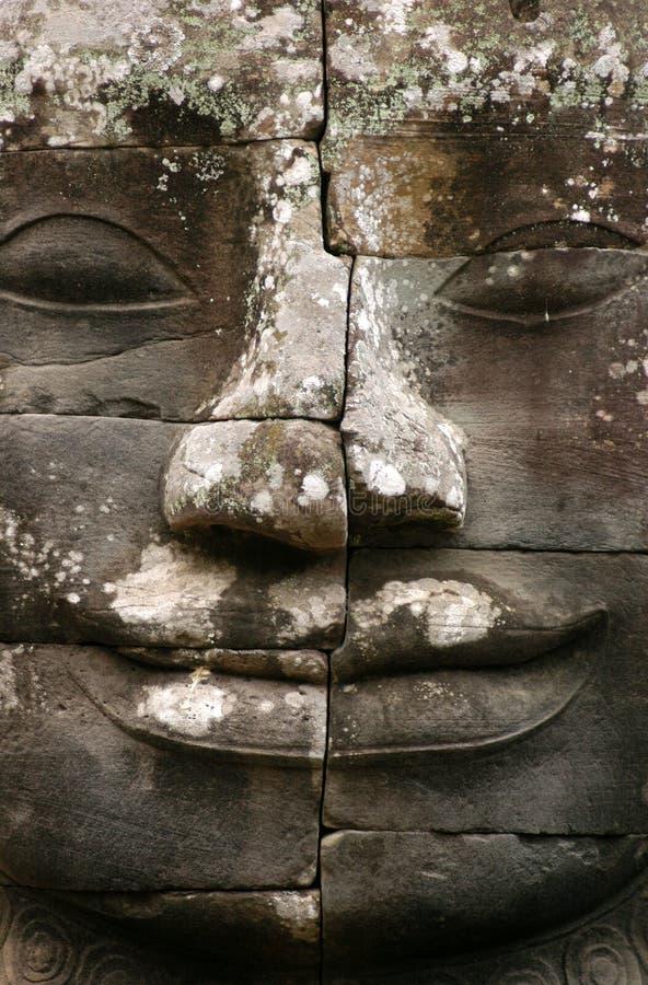 Het Gezicht van de Steen van Angkor stock afbeeldingen