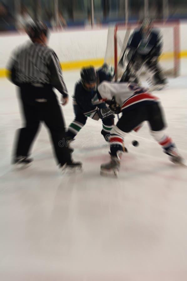Het gezicht van het ijshockey van actieonduidelijk beeld royalty-vrije stock afbeelding
