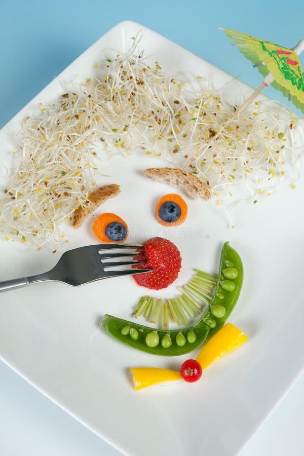 Het gezicht van het voedsel op plaat royalty-vrije stock afbeelding