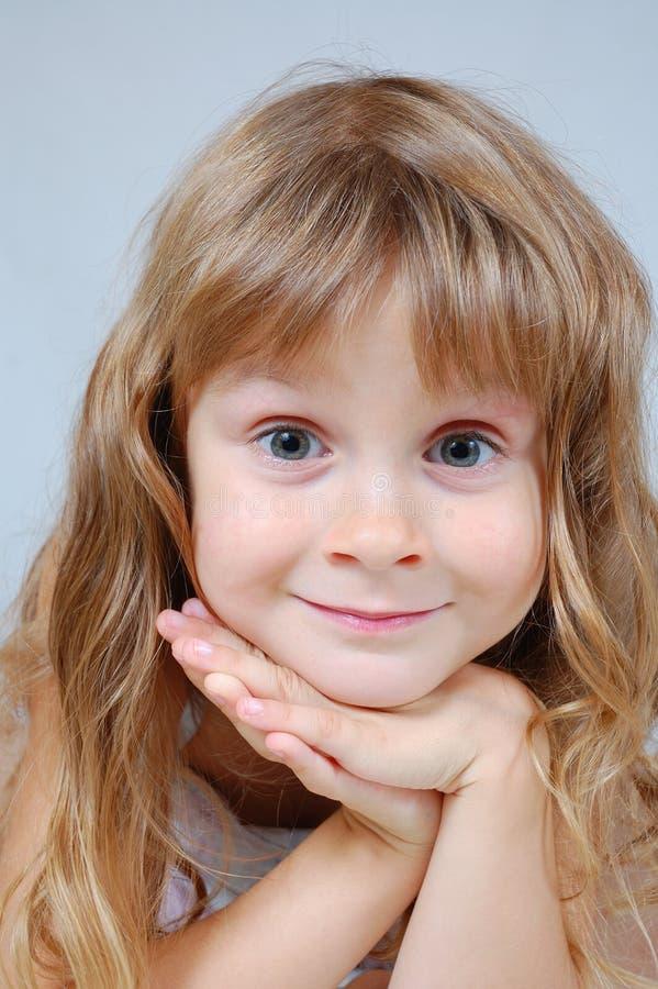 Het gezicht van het zoete het glimlachen meisje stock fotografie