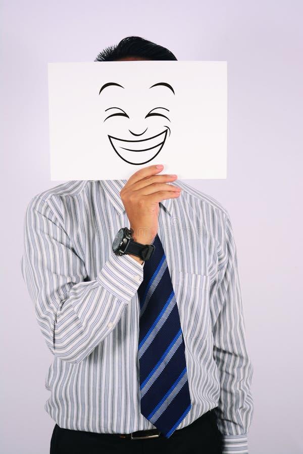 Het Gezichtsmasker van zakenmanwearing happy laughing royalty-vrije stock afbeeldingen
