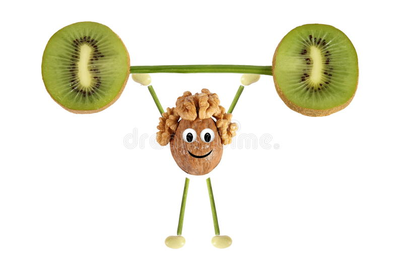 Het gezonde eten. De grappige kleine mensen van de okkernoot heffen kiwibedelaars op royalty-vrije stock afbeeldingen