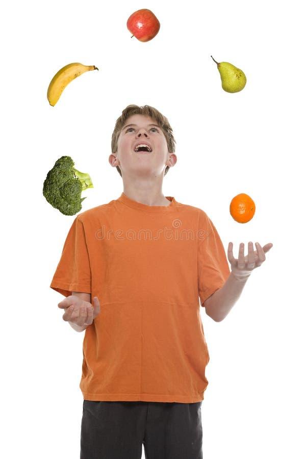 Het gezonde Voedsel jongleert met stock fotografie