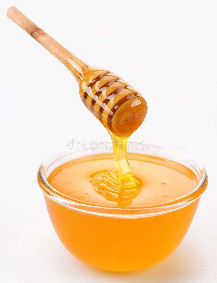 Het gieten van de honing royalty-vrije stock afbeelding