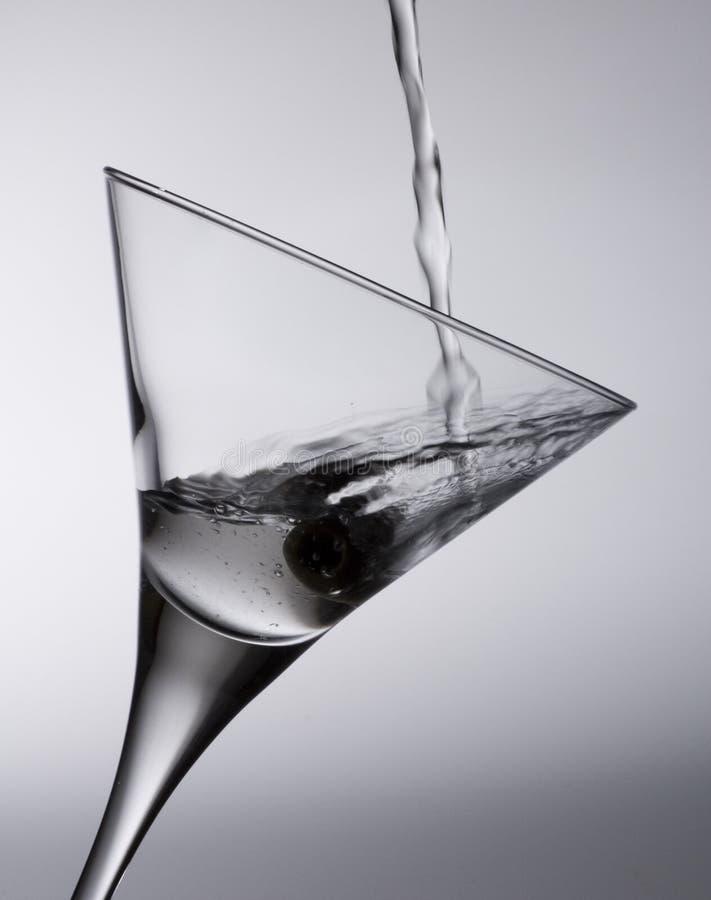 Het glas en de vloeistof van de cocktail royalty-vrije stock afbeeldingen
