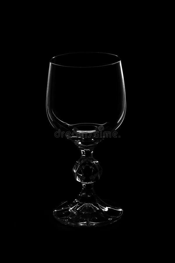 Het glas van de wijn op zwarte achtergrond royalty-vrije stock foto