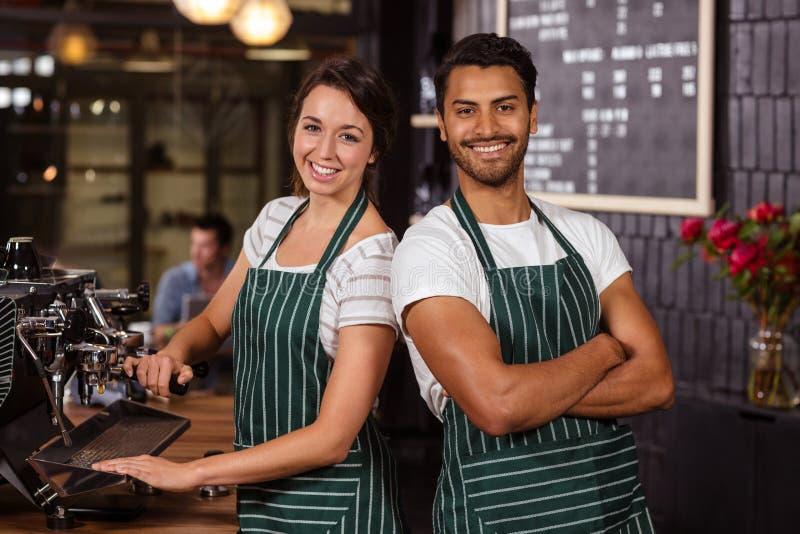 Het glimlachen baristas het werken royalty-vrije stock foto's