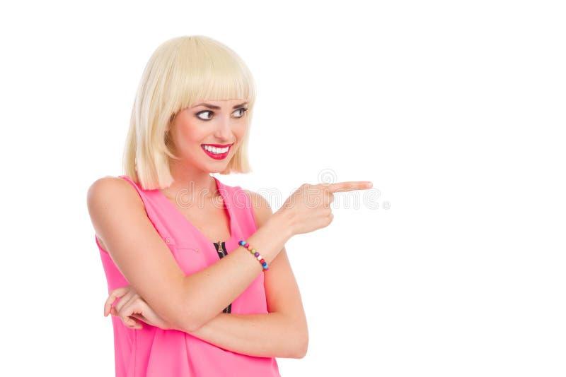 Het glimlachen blondevrouw het richten stock fotografie