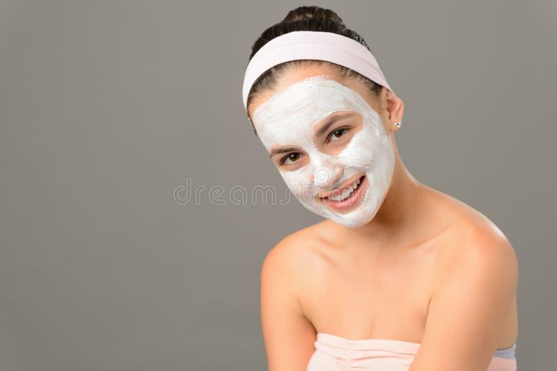 Het glimlachen de schoonheid van de het maskerhuid van tienerschoonheidsmiddelen stock foto