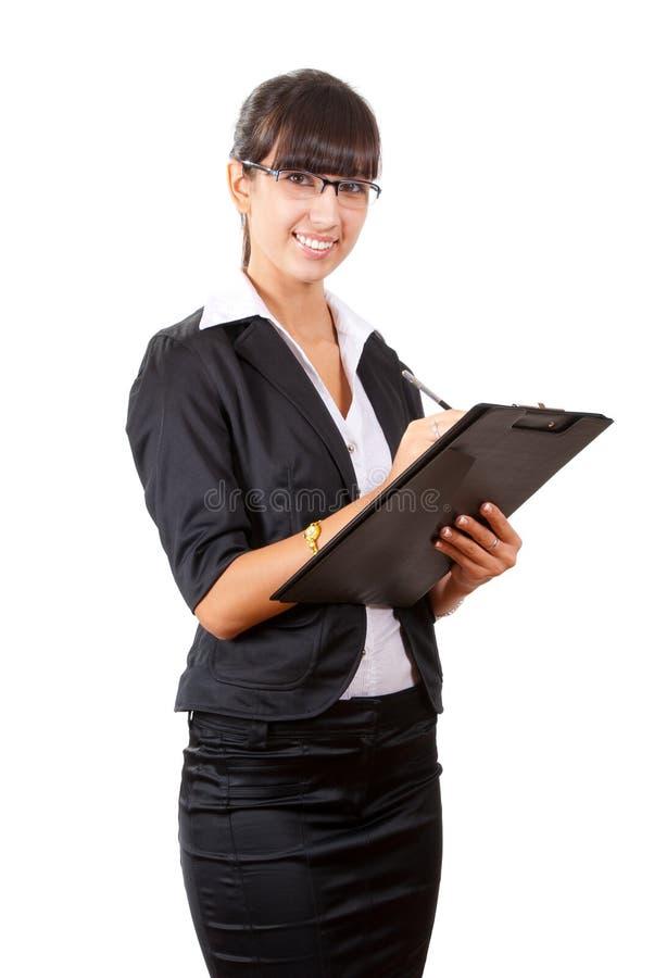 Het glimlachen het bedrijfsvrouw schrijven royalty-vrije stock afbeeldingen