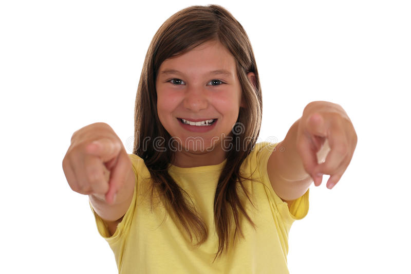 Het glimlachen het jonge meisje richten met haar vinger wil ik u royalty-vrije stock afbeelding
