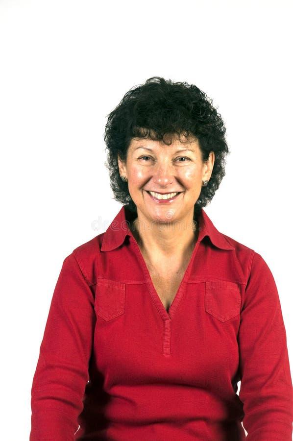 Het glimlachen het portret van de middenleeftijdsvrouw royalty-vrije stock foto's