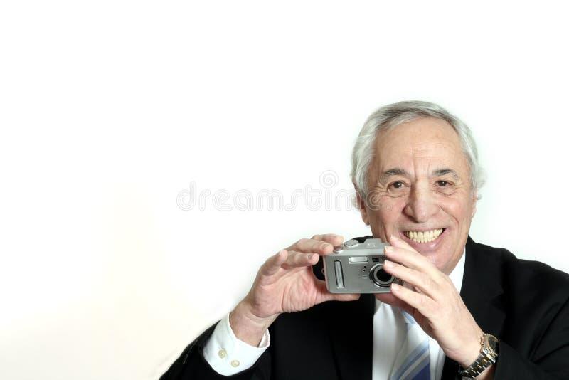 Het glimlachen met camera royalty-vrije stock fotografie