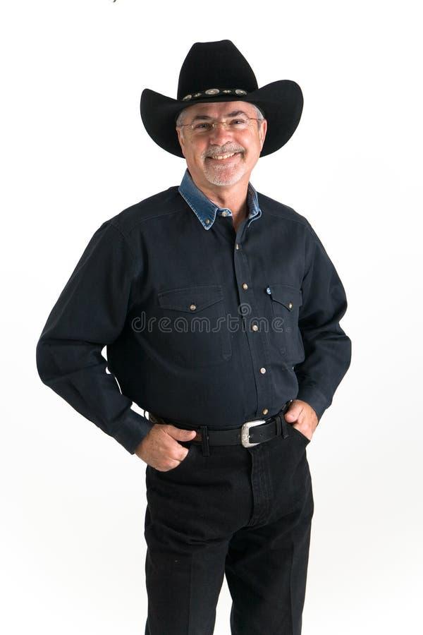 Het glimlachen van de cowboy stock foto's