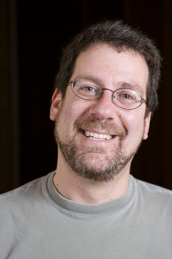 Het glimlachen van de mens stock fotografie
