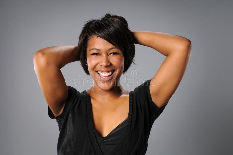 Het Glimlachen van de vrouw stock foto's