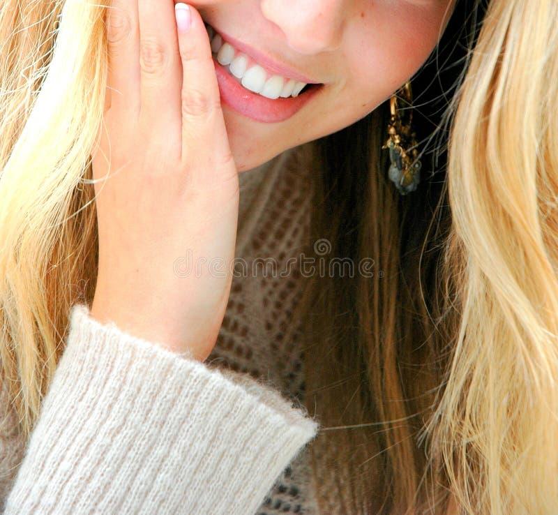 Het glimlachen van de vrouw stock foto