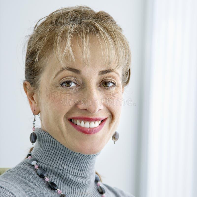Het glimlachen van de vrouw. royalty-vrije stock fotografie