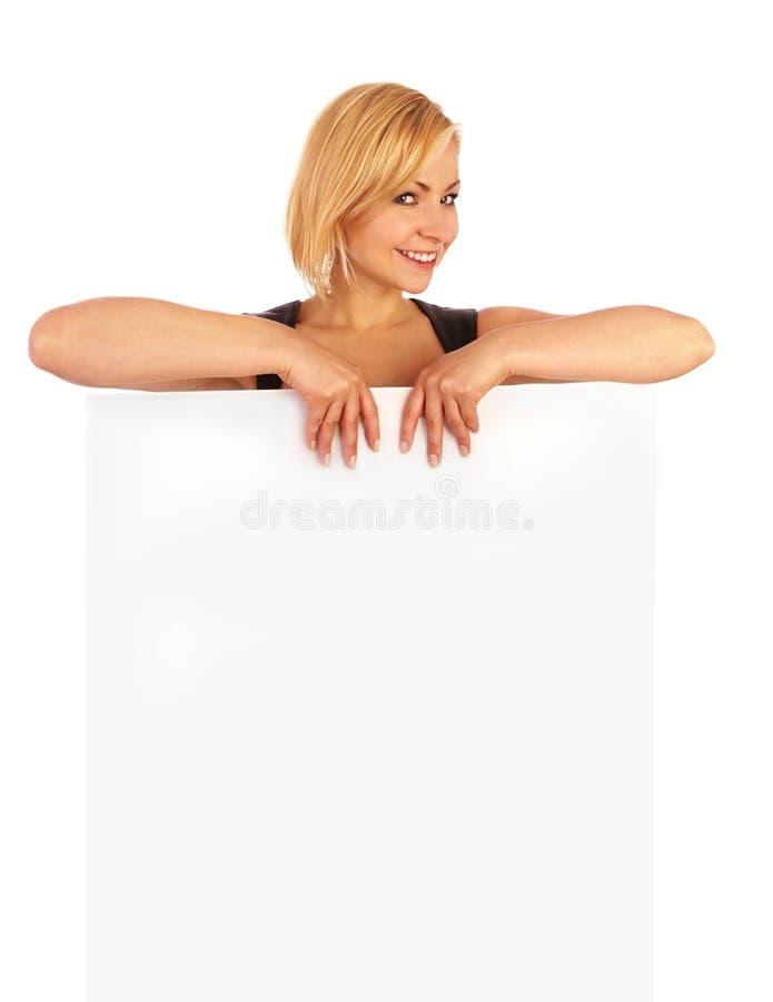 Het glimlachen van het meisje met een banner royalty-vrije stock foto's
