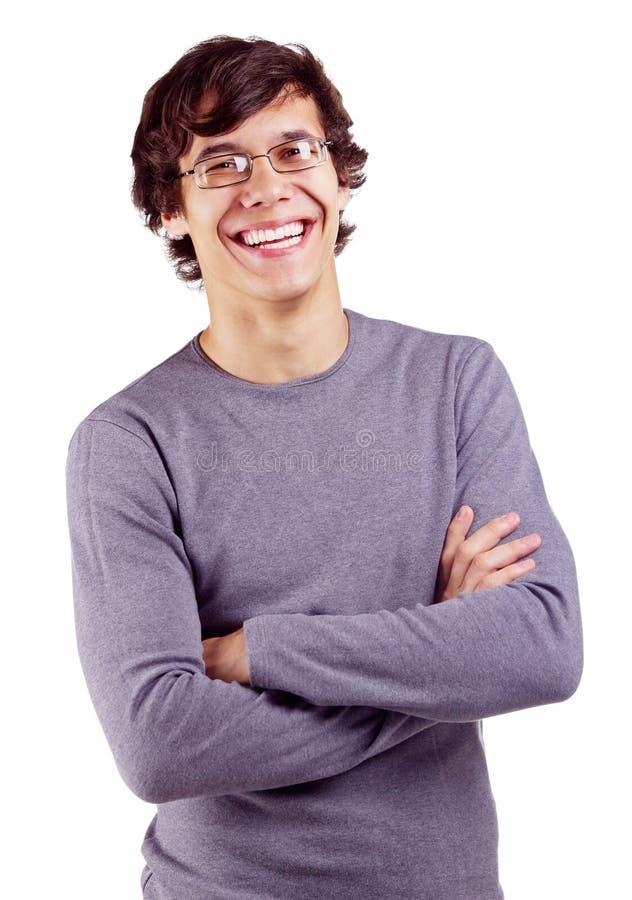 Het glimlachen van kerel met gekruiste wapens stock foto's