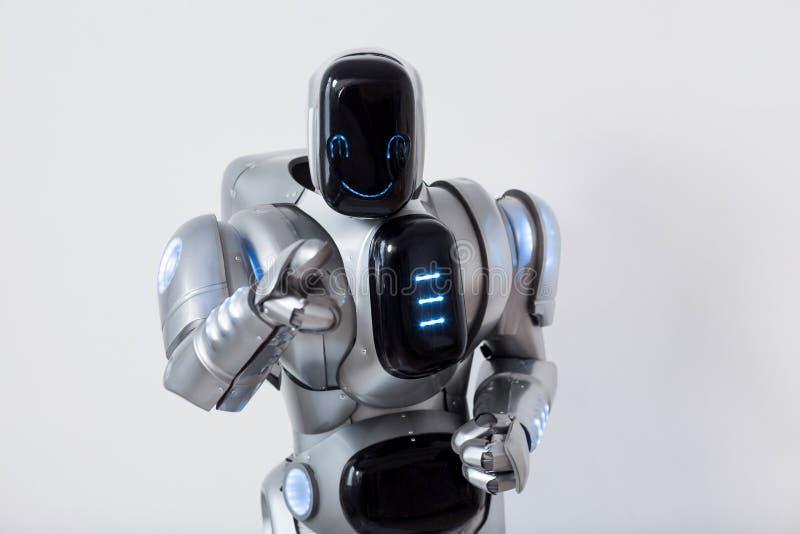 Het glimlachen van robot die u richten stock foto's