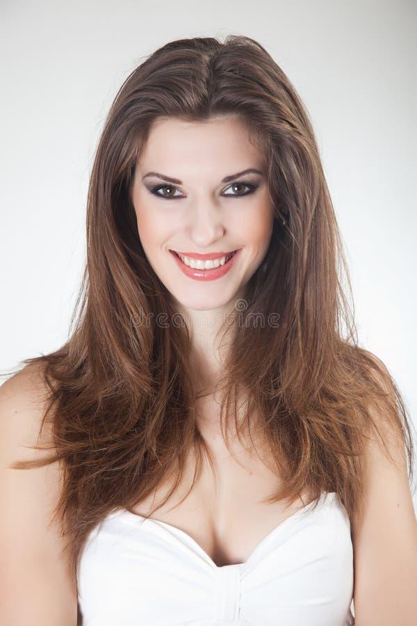 Het glimlachen van vrij jong meisje stock foto