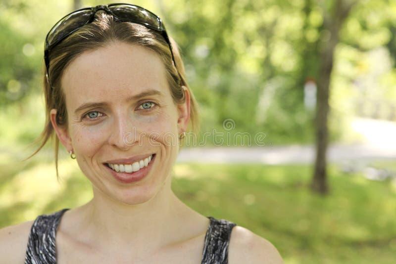 Het glimlachen van vrouwen stock foto's