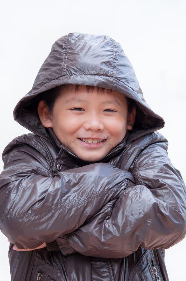 Het glimlachen van weinig Aziatische jongen royalty-vrije stock afbeeldingen