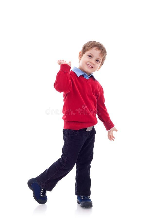 Het glimlachen van weinig jongen in jeans stock fotografie