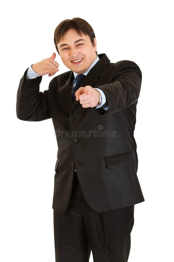 Het glimlachen zakenman het tonen contacteert me gebaar royalty-vrije stock foto's