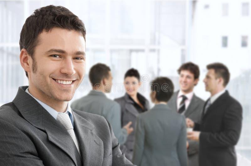 Het glimlachen zakenmanportret stock afbeeldingen