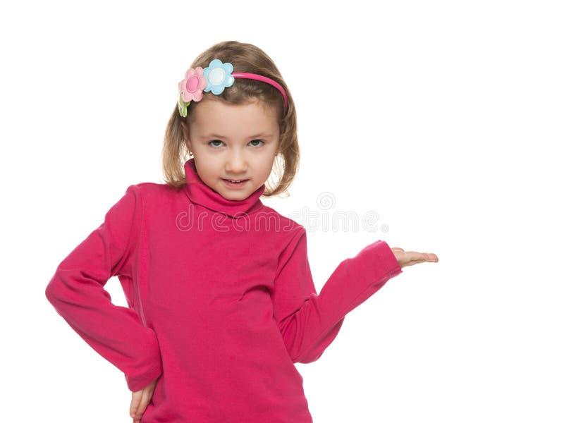 Het glimlachende meisje maakt een handgebaar stock afbeeldingen