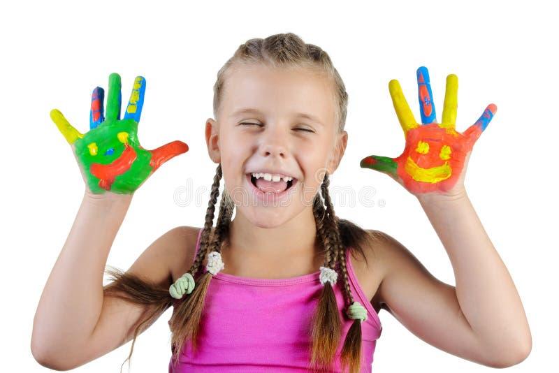 Het glimlachende meisje met de palmen schilderde door een verf. royalty-vrije stock afbeelding