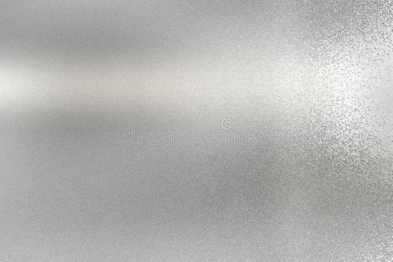 Het gloeien borstelde zilveren staalplaat, abstracte textuurachtergrond stock foto's
